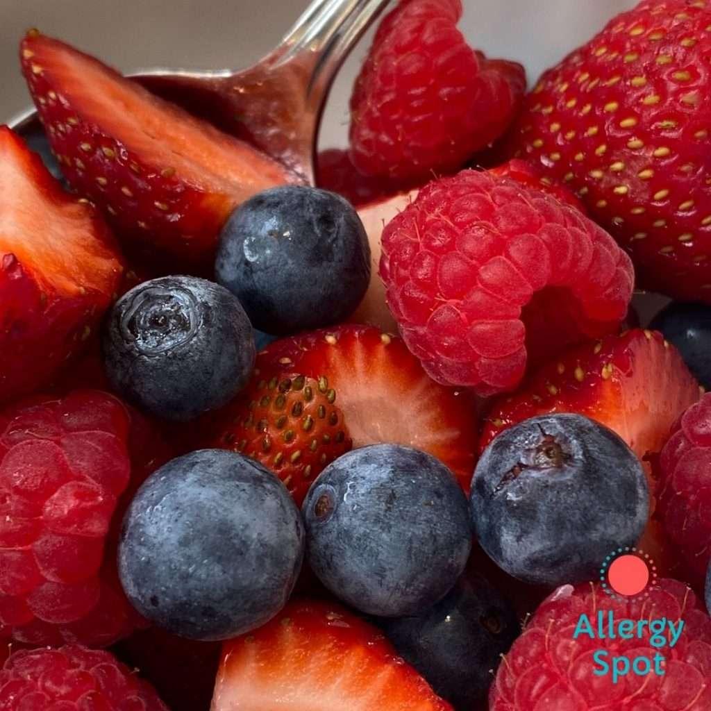 Bowl of fresh strawberries, raspberries and blueberries